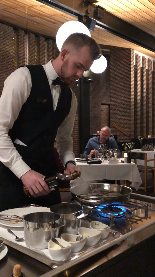 Chef Cooking In Front Of Customer