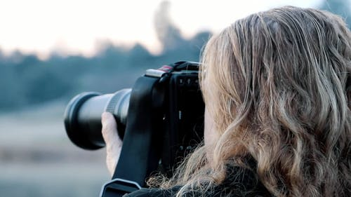 Photographer Taking Pictures with a DSLR