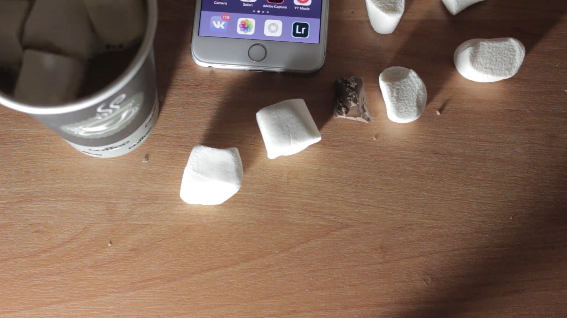 Smartphone On Table With Chocolates and Marshmallows