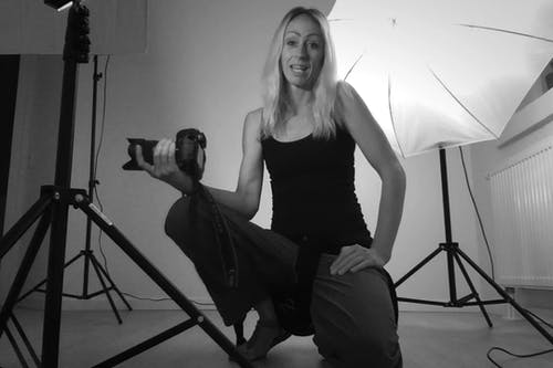 Woman Photographer Recording A Video of Herself