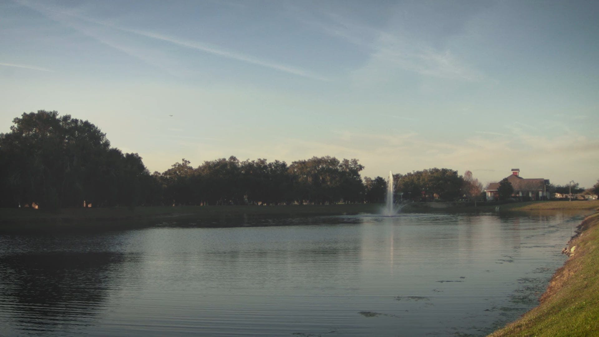 A Lake With A Fountain On A Park
