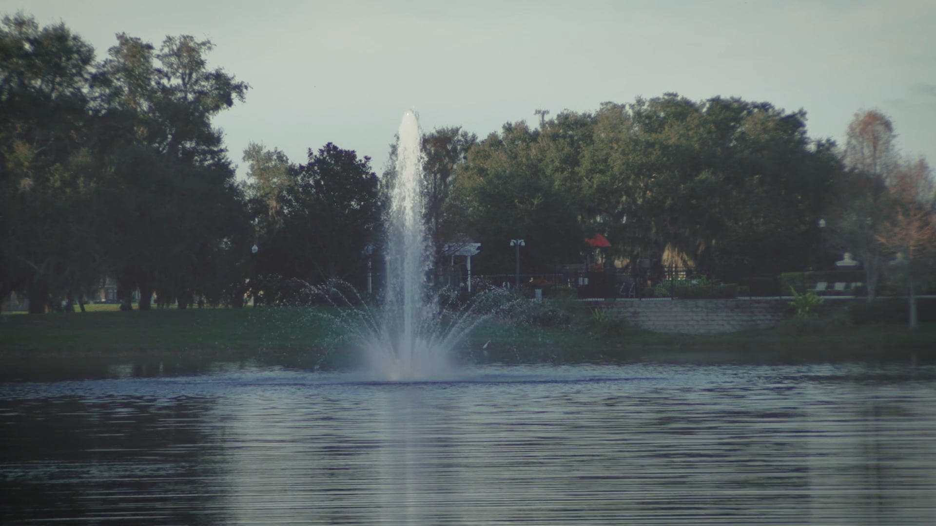 Fountain In The Lake At A Park