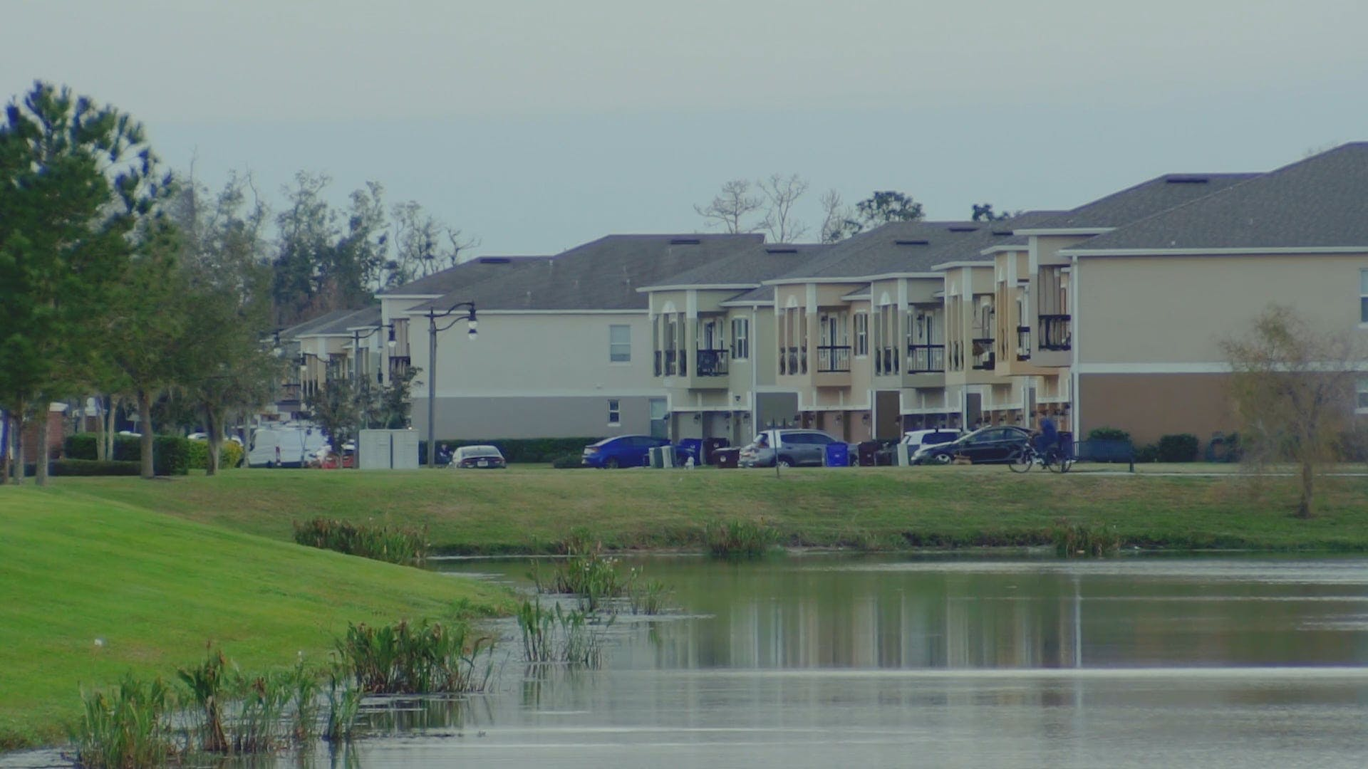 Front View Of Apartments With A Lake