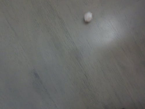A Dice Thrown On A Wooden Surface