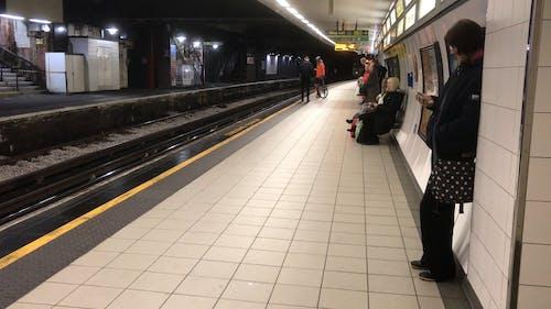 Passengers Waiting At A Train Station