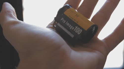 Person Holding A Film Of Camera