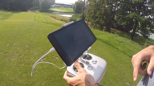 Man Holding A Controller With Smartphone