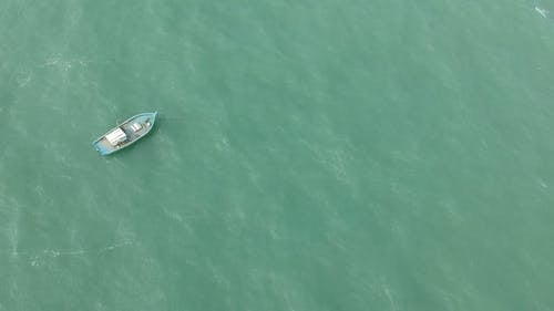 Aerial View Of An Empty Boat In The Sea
