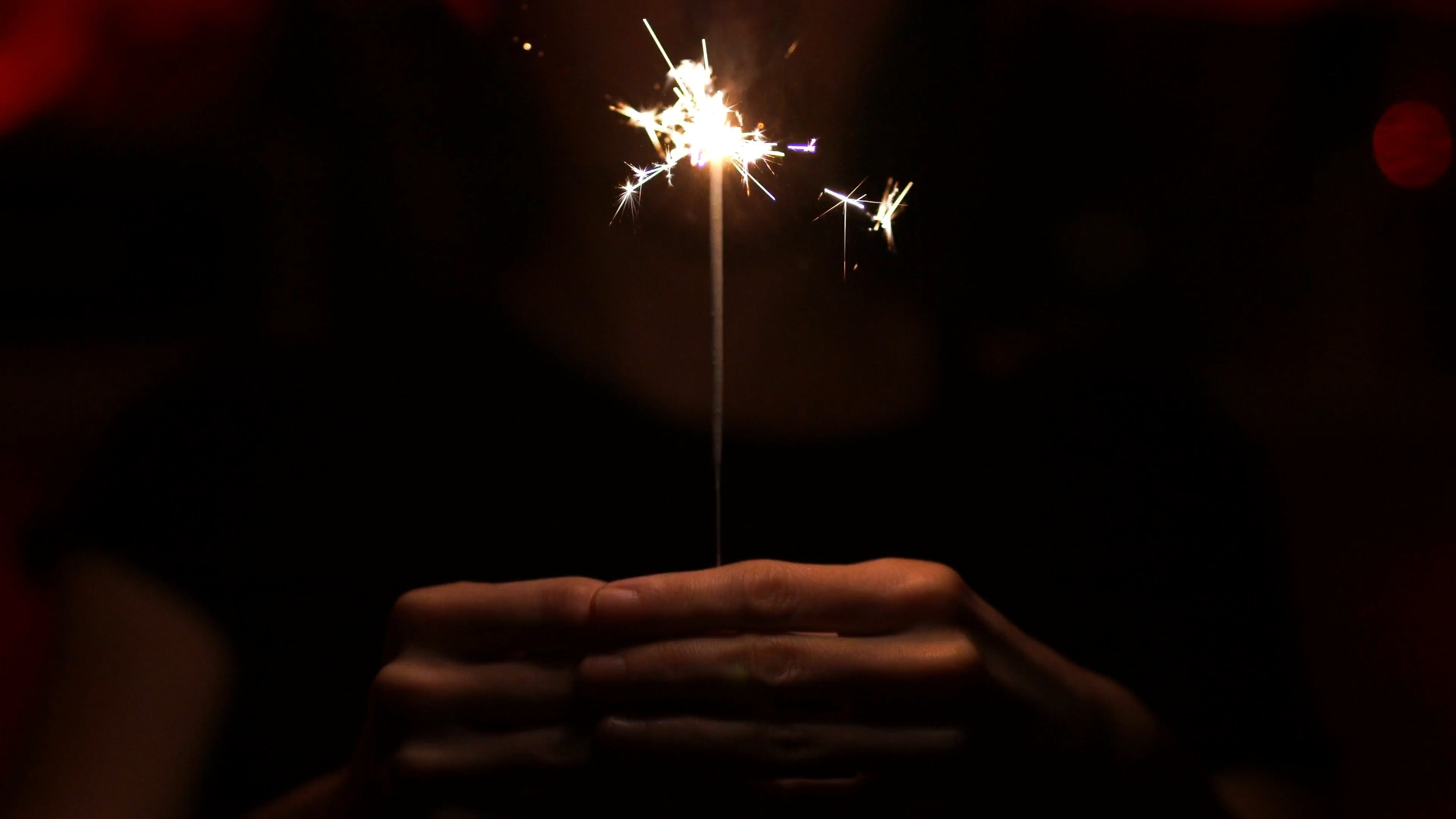 Person Holding Sparkler