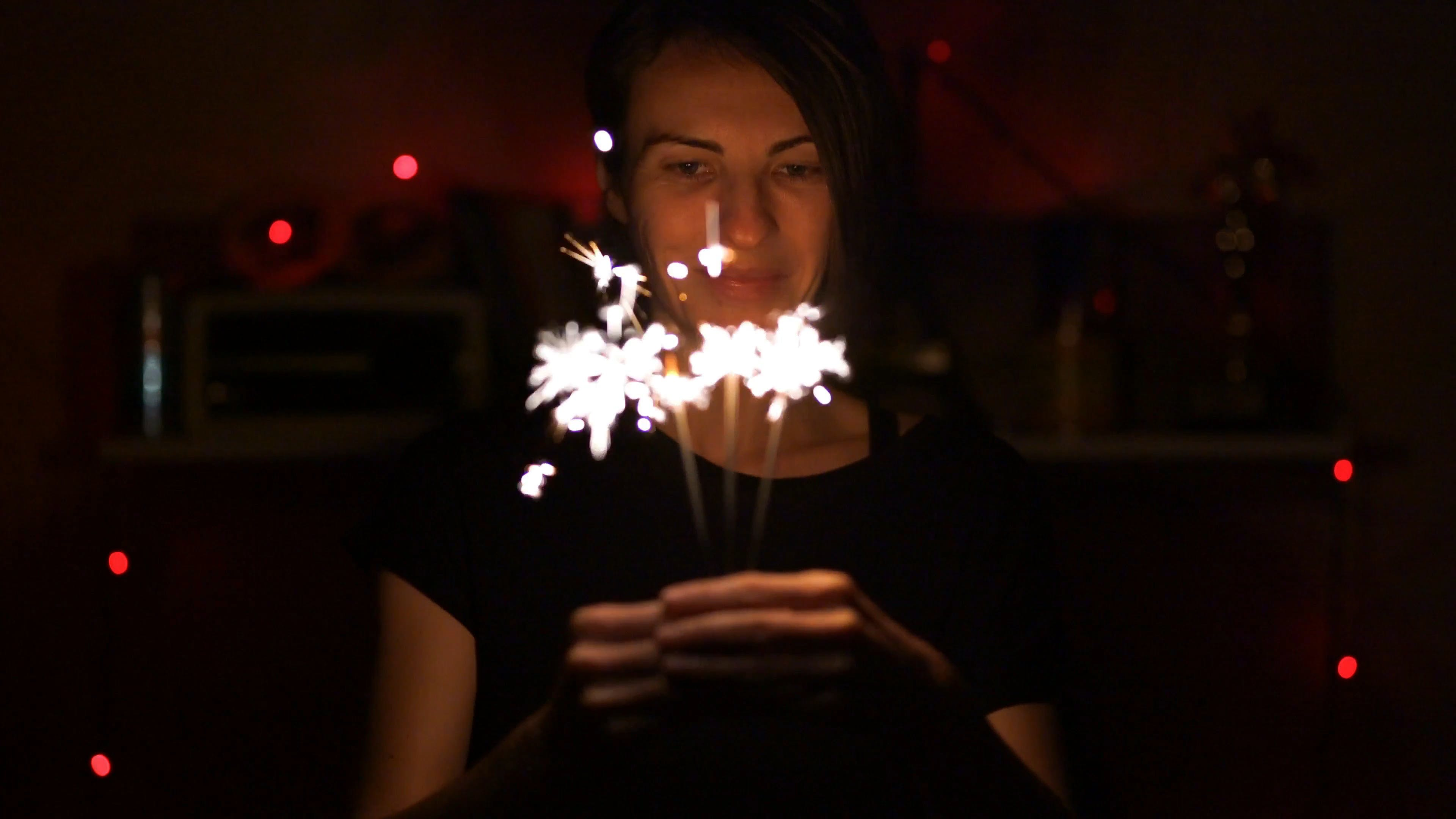 Woman Holding A Bunch Of Sparklers