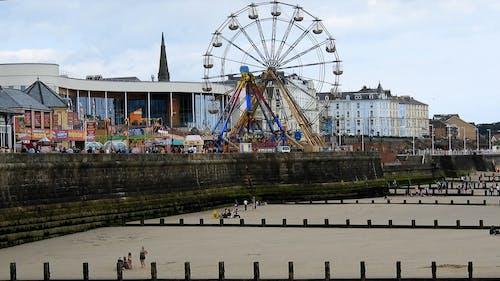 Fairground Near A Sea Wall