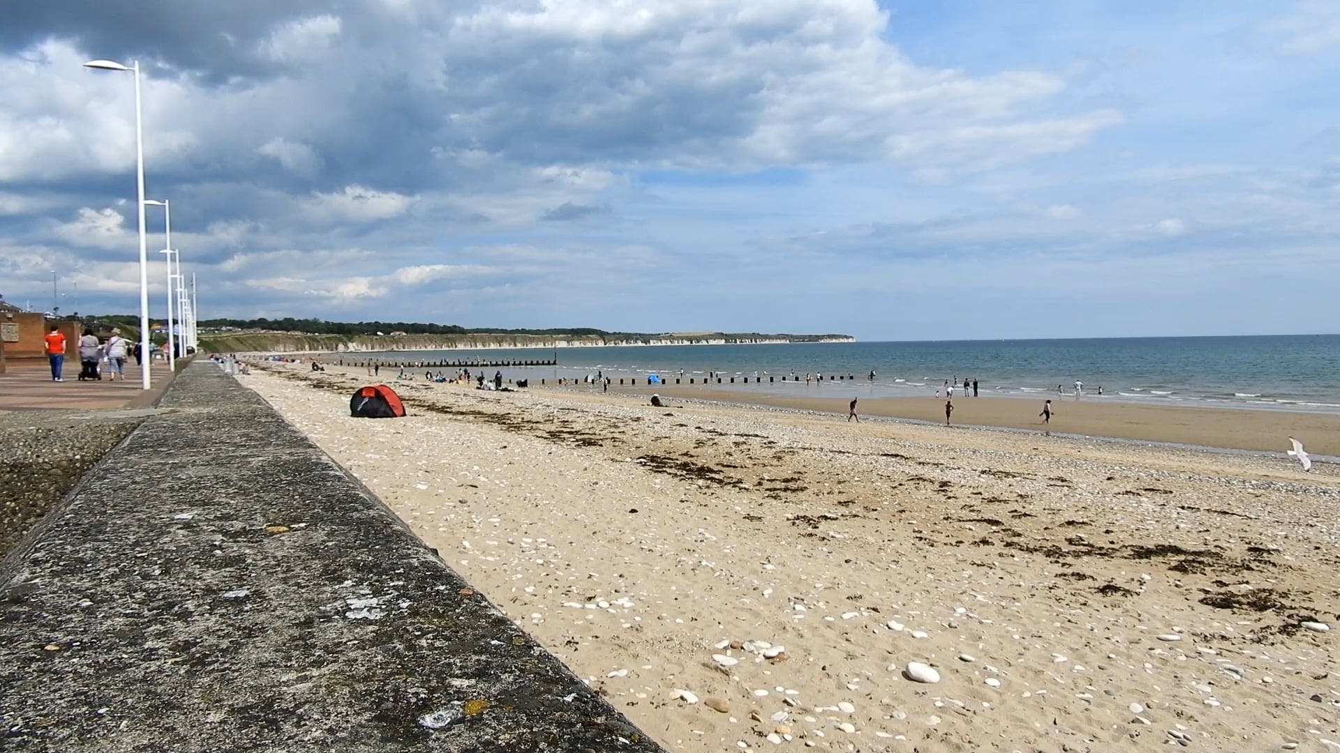 People Enjoying The Beach At Summer