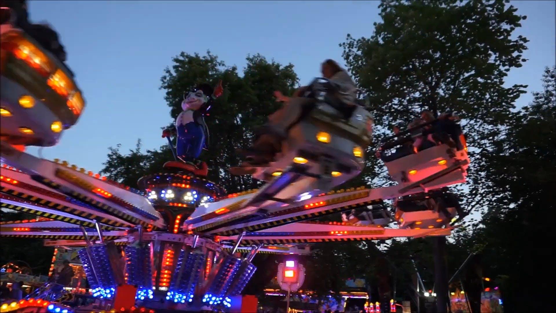 People Having Fun At An Amusement Park