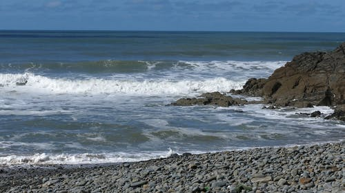 View Of Sea Waves Crashing