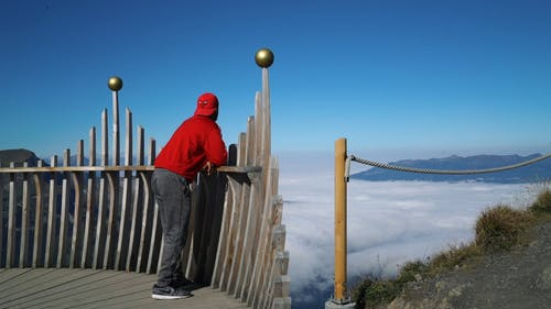 Man Overlooking View Of Mountain