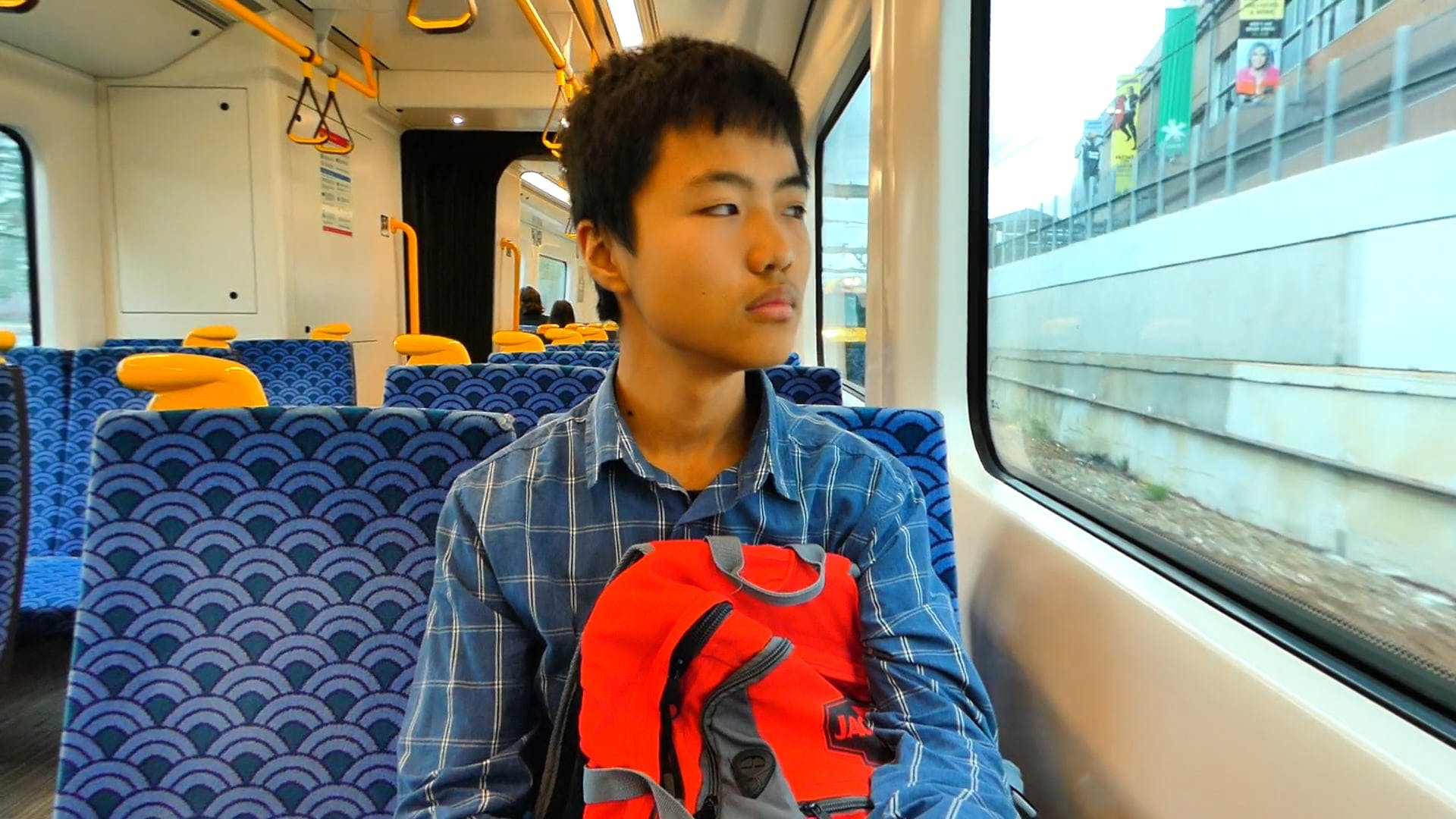 Boy Riding In A Train