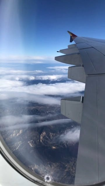 View Of An Airplane S Wing From Window