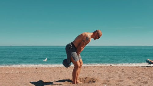 Man Doing Lifting Exercises With Kettlebell