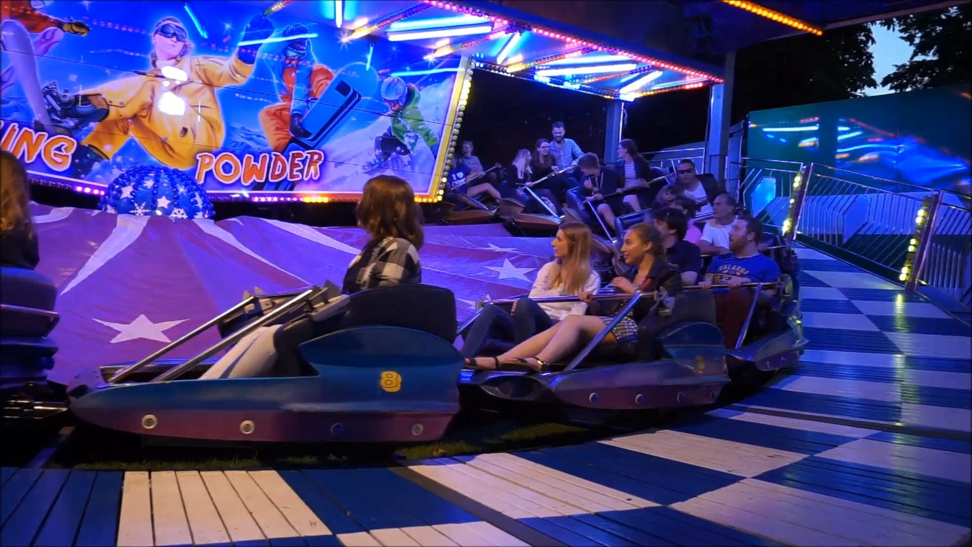 People Enjoying A Ride At The Carnival