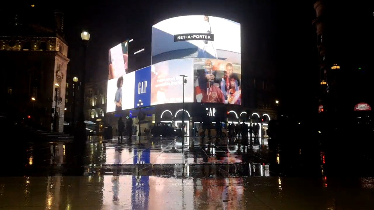 Illuminated Billboard In The Business Center Of City