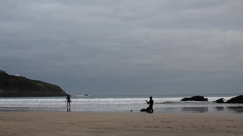 People Surfing At The Beach