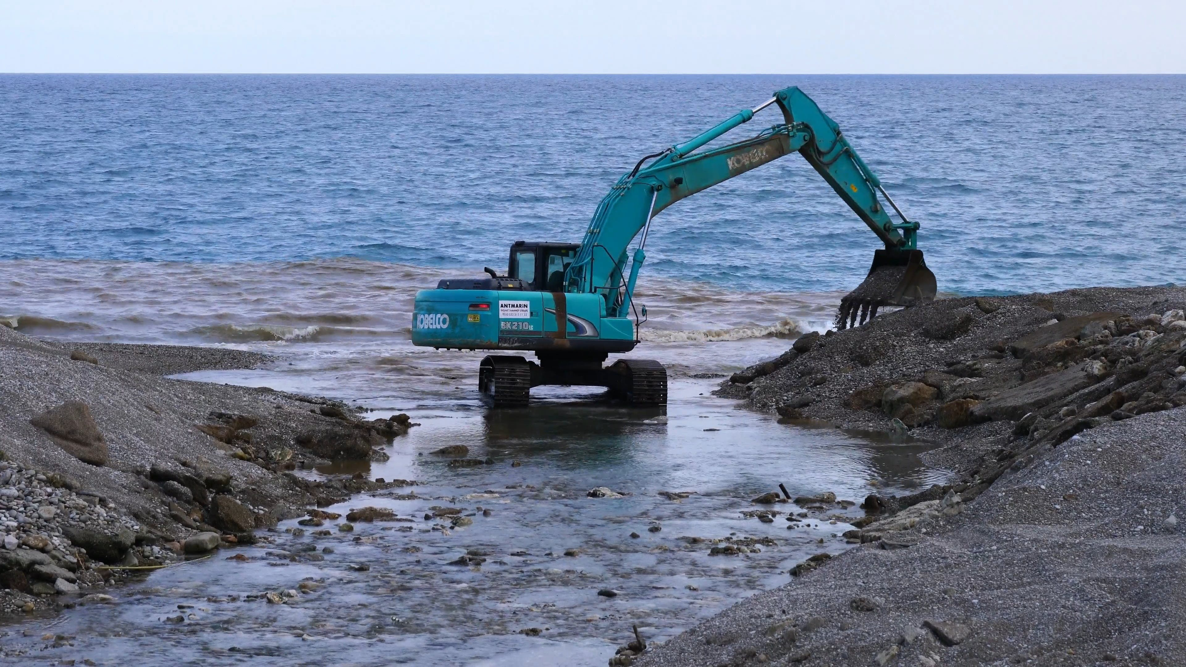 Backhoe At The Beach