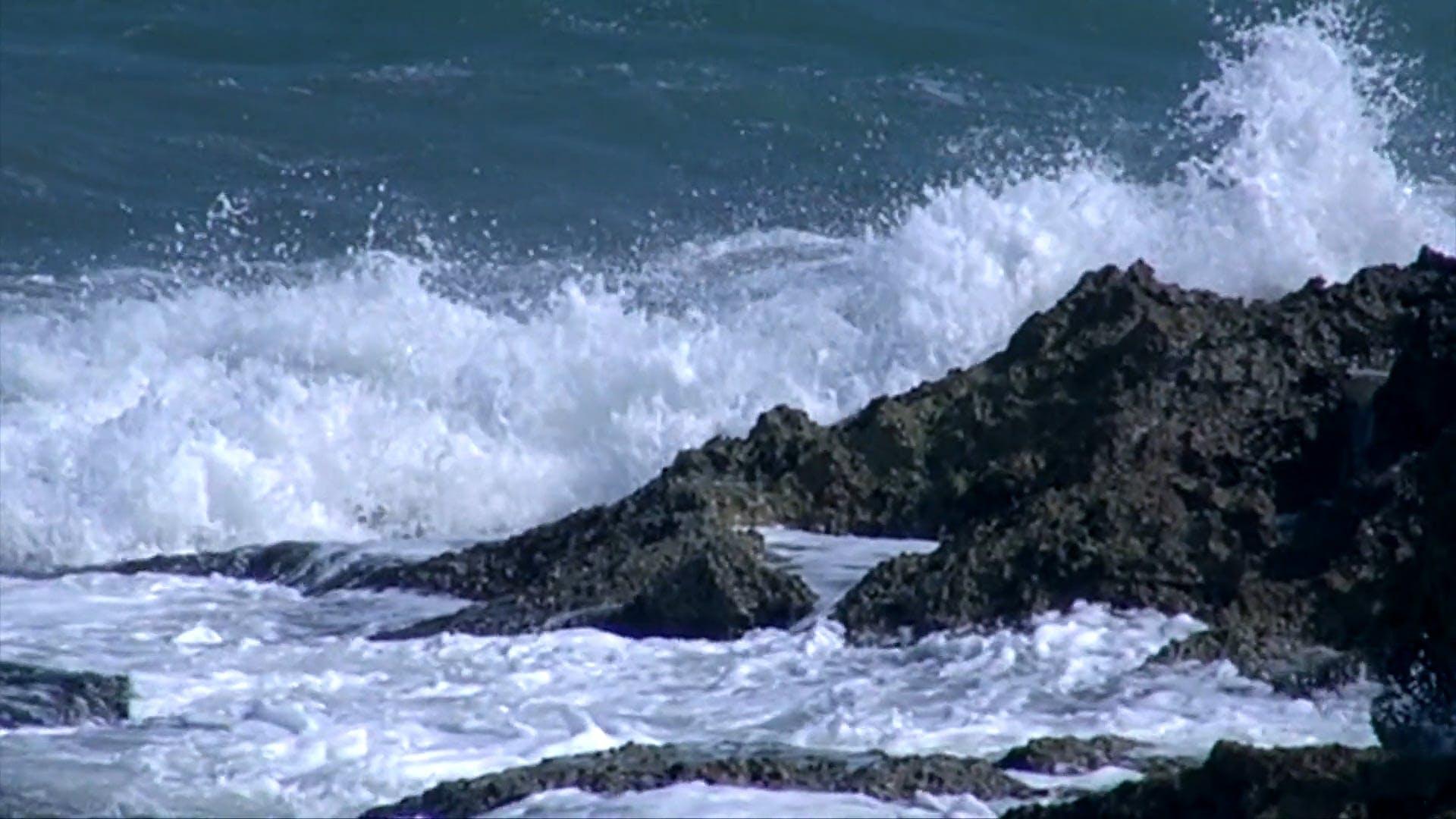 Waves Crashing To The Rocks