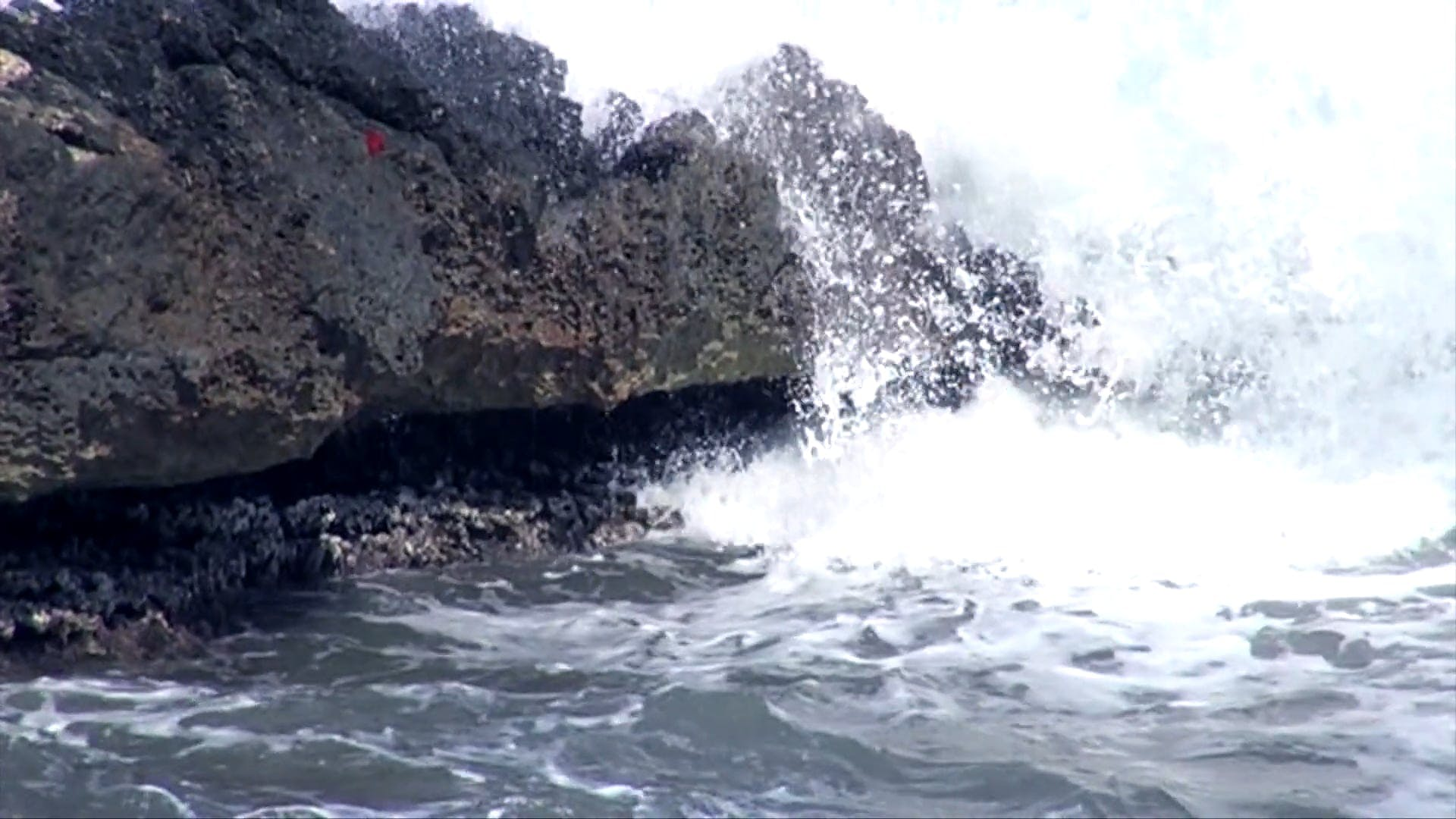 Slow Motion View Of Waves Crashing To The Rocks
