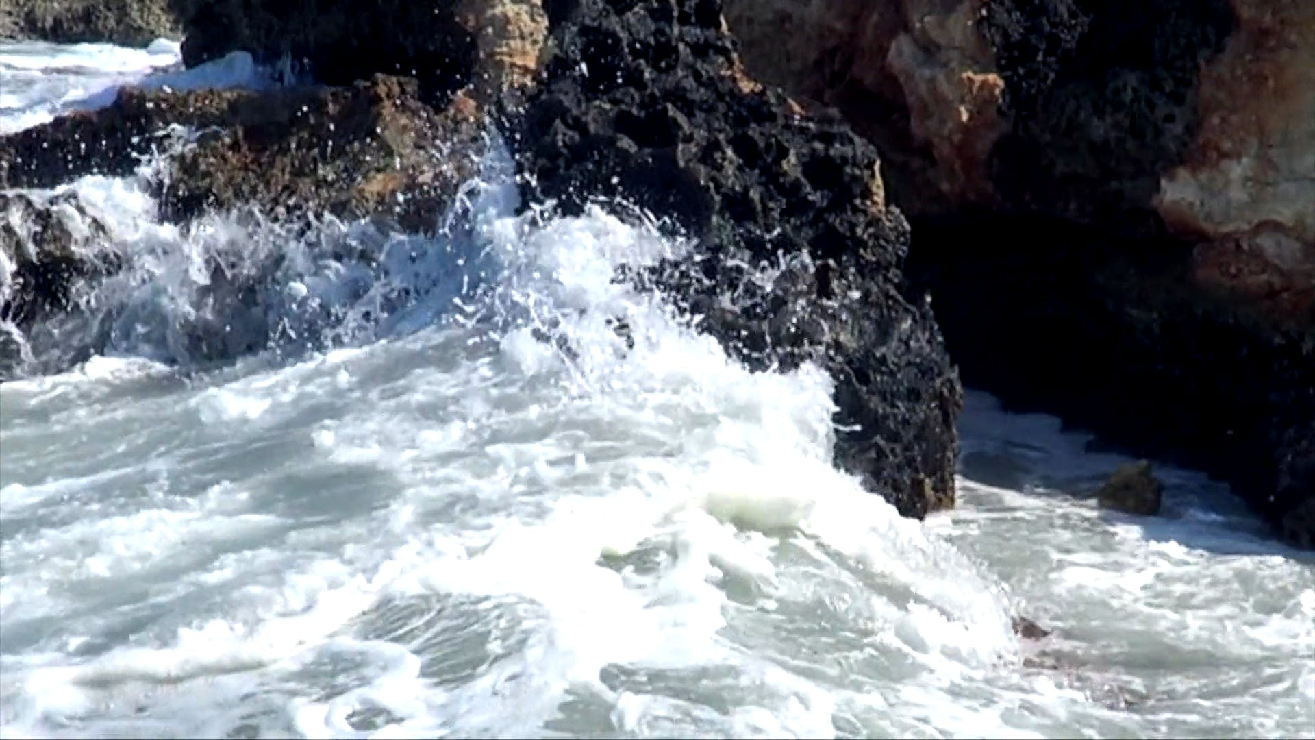 Waves Crashing On Rocks
