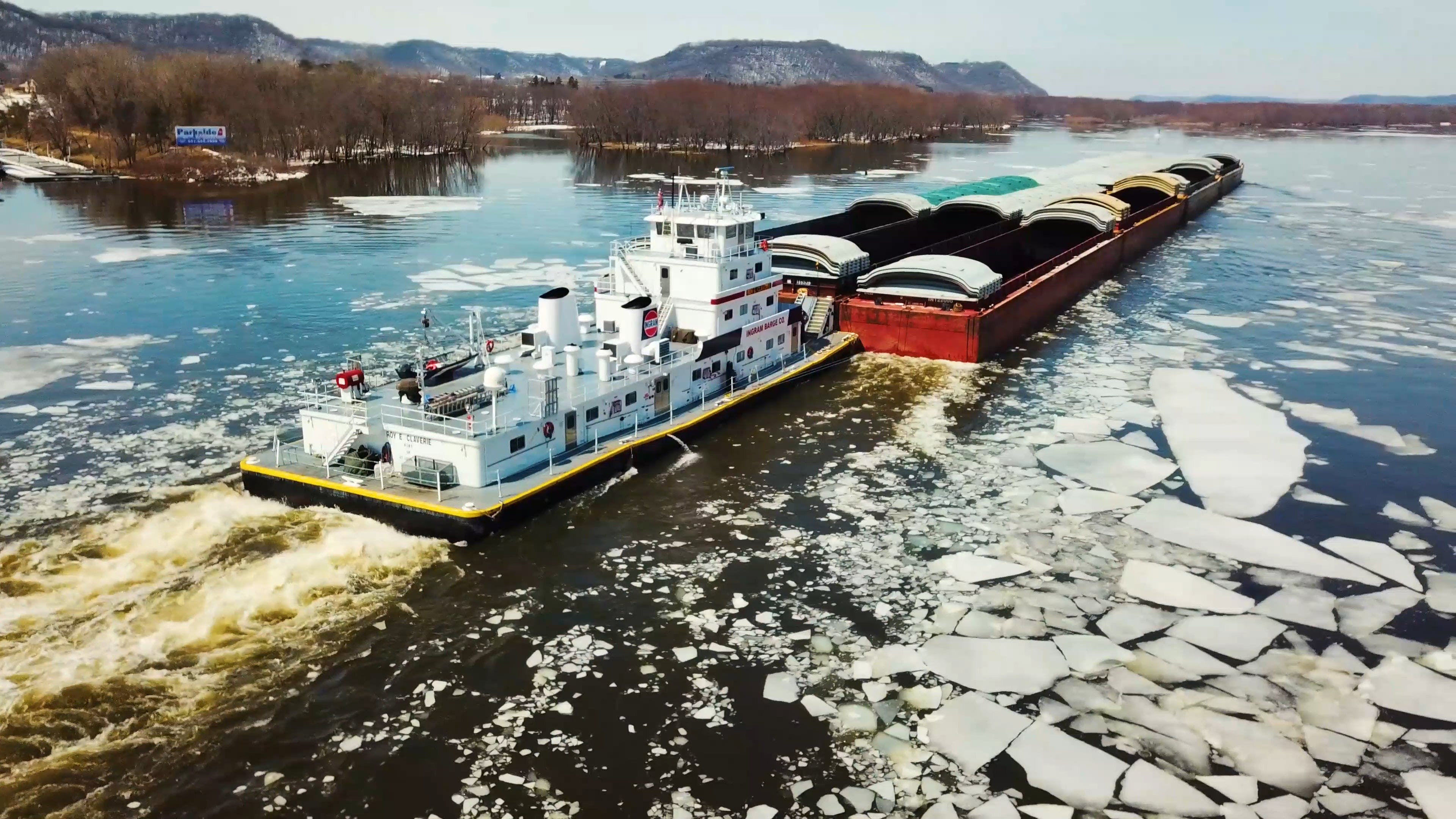 A Barge Sailing The River With Icebergs