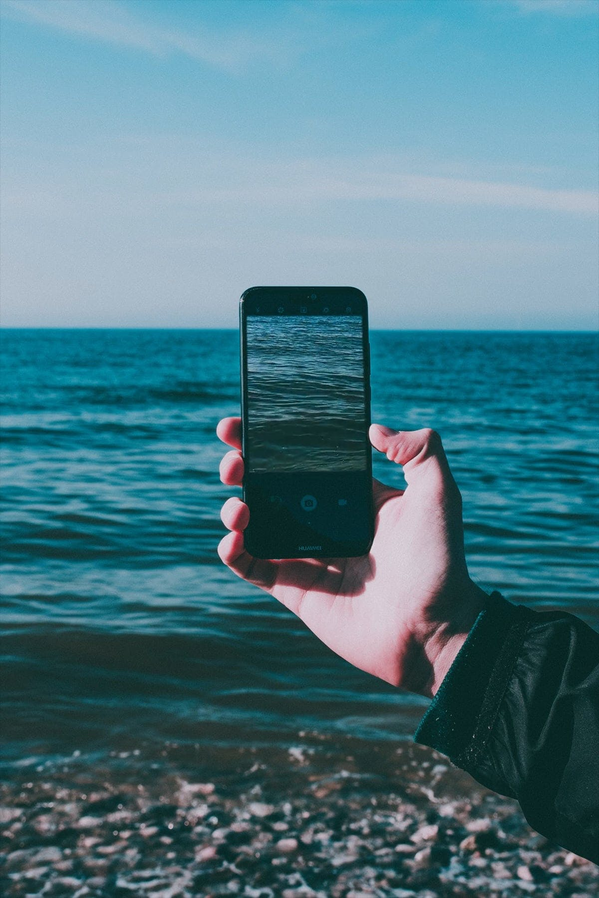 Person Holding Smartphone