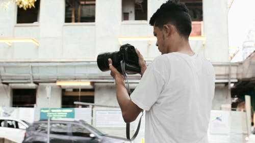 Man Taking Pictures Of Different Views