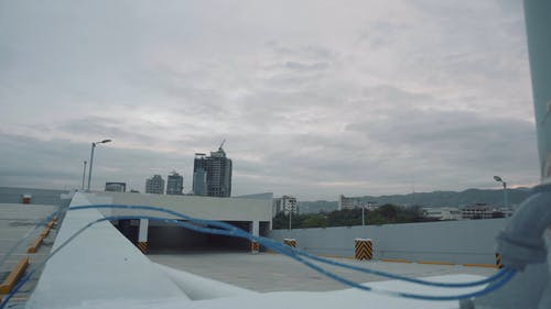 Rooftop Parking Area With Cloudy Sky in Timelapse