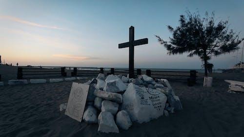 Wooden Cross On A Beach