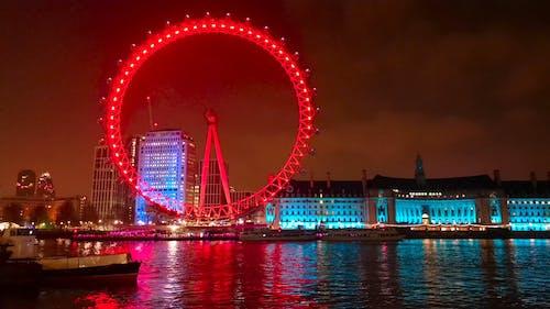Night View of City With Illuminated Ferris Wheel
