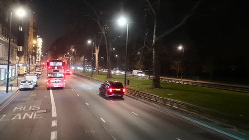 Vehicles On The Road At Nightime