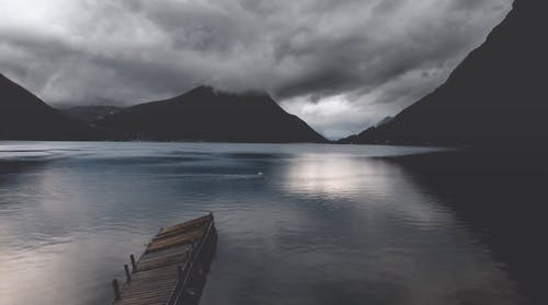 Time Lapse Footage Of Clouds Over A Lake And Mountains
