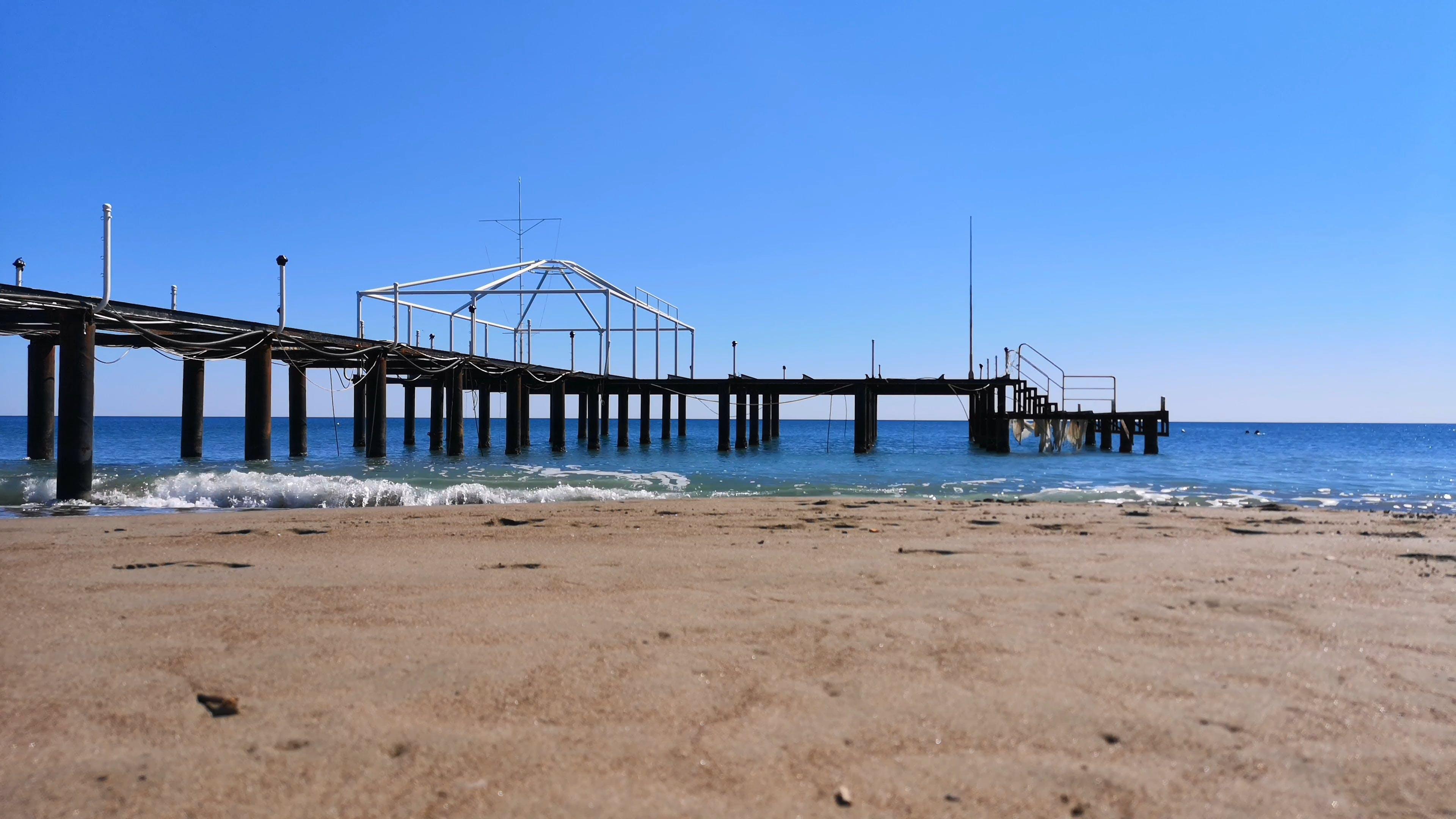 Beach With Wooden Boardwalk