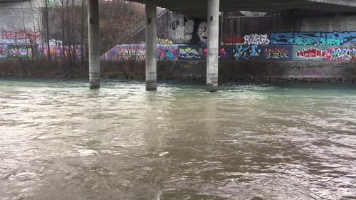 River With Graffiti On Wall
