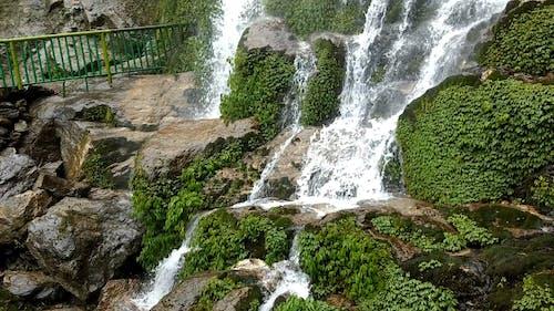 Waterfalls On A Rocky Mountain