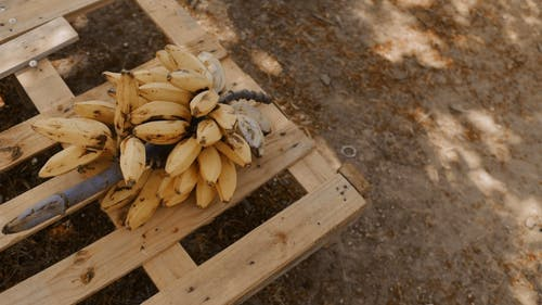 Ripe Bananas On A Crate