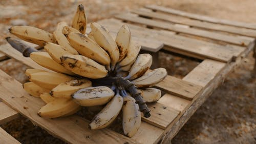A Cluster Of Bananas On A Crate