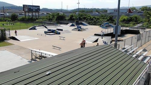 Boys Skateboarding In A Park