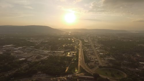 Aerial Photography Of Town With View Of Sunset