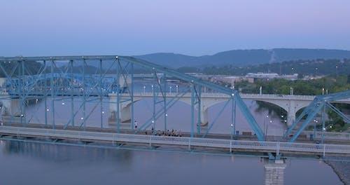 Two Parallel Bridges Above A River