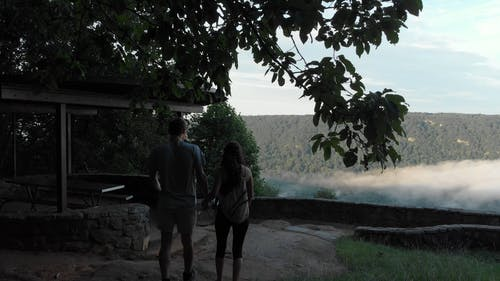 Couple Overlooking The View Of A Beautiful Landscape