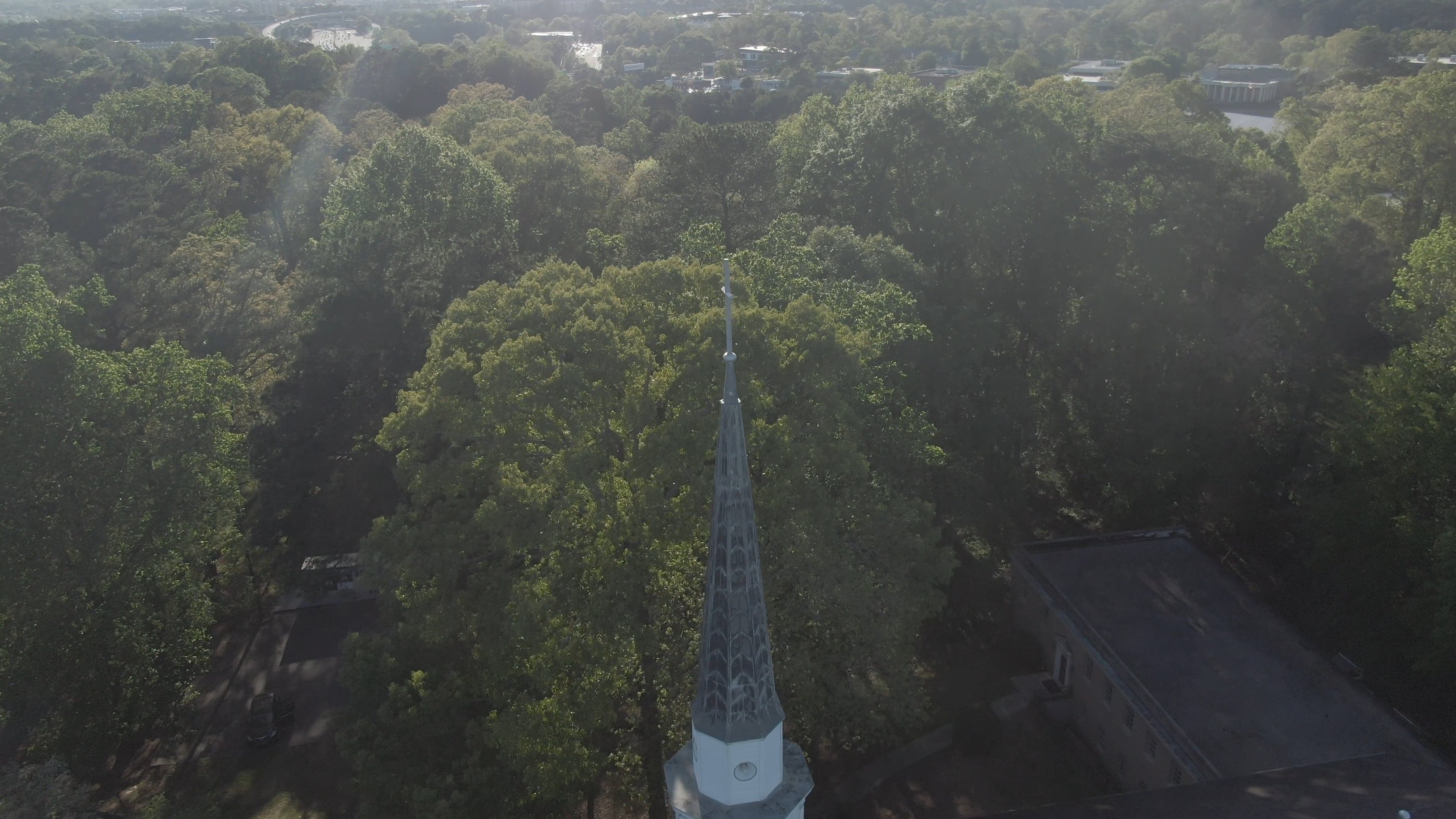View Of Church Tower In The Middle Of Trees