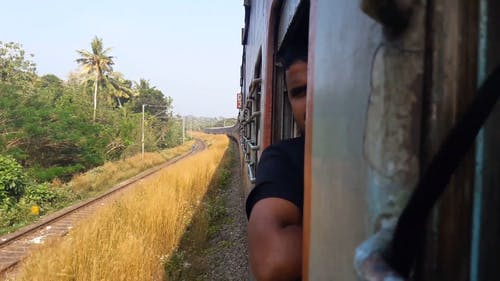 Man Travelling By Train