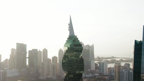Tall Green  Building With Glass Panels