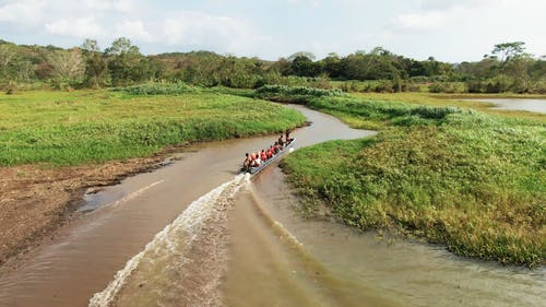 A Motorboat Traversing A Narrow Stream